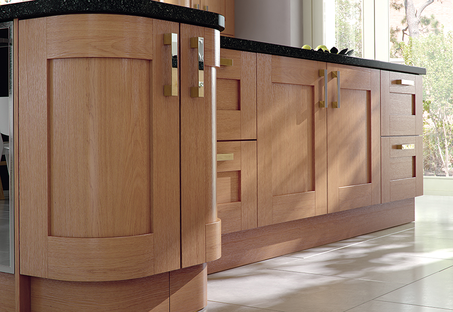 http://www.ianwoodbespokeinteriors.co.uk/wp-content/uploads/2017/01/modern-contemporary-classic-windsor-shaker-oak-kitchen-island-quadrant-doors-1.jpg